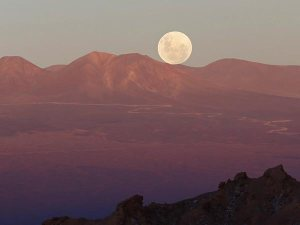 This moon, seen from San Pedro de Atacama, Chile, was the largest of 2012. This year's supermoon will occur on June 23, and appear 8 percent larger and 17 percent brighter.